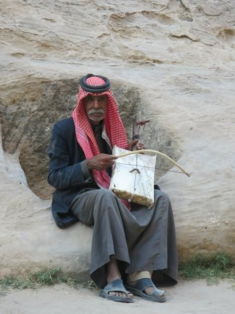 Beidha : an old Bedouin playing his Rababa