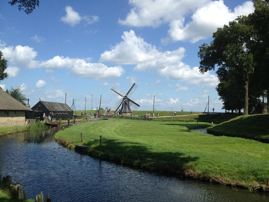 Zuiderzee Museum (Zuiderzeemuseum): view from the town at the mill and the dyke