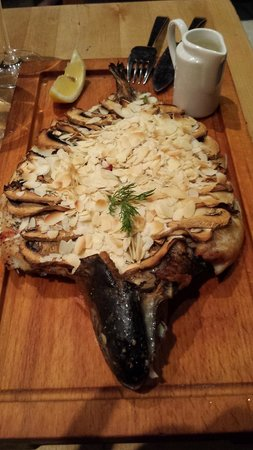 The Club Yerevan : grilled trout topped witf almond flakes and mushrooms
