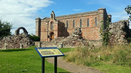 Coldingham Priory: Old arch, ruins and new church