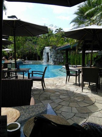 Hotel Vila Lumbung: Pool area with waterfall in front of cave and gardens