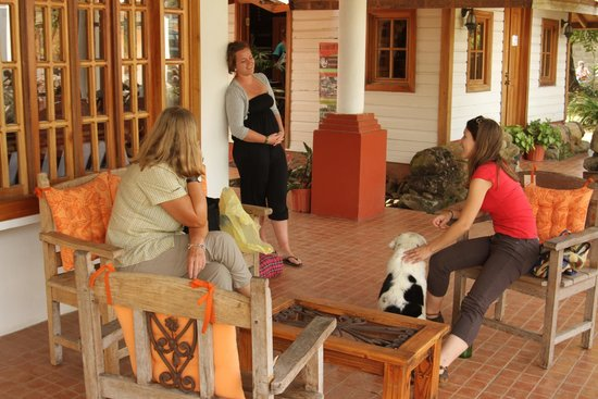 Spanish by the River-Boquete: Hostel - Front with chairs & hammocks