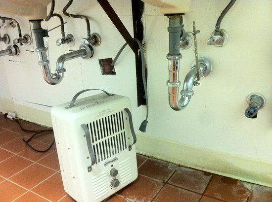 Jackson Hole Campground at Fireside Resort: Space heater wiring; note sink leak nearby