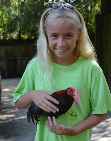 "Magnolia Plantation & Gardens: Grand-daughter with ""Roadie,"" the friendly chicken"