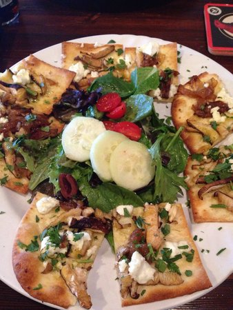 The Pantry: Goat cheese, caramelized onion flatbread with portobellos & parsley with a small salad with kala