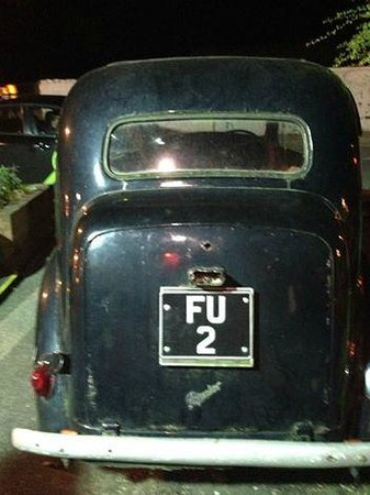 Johnnie Fox's Pub : Old Car in Parking Lot Shows the Attitude :)