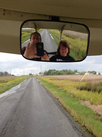 Smith Island Inn: Dr. Jim and Sally driving the golf cart around having fun on the island.