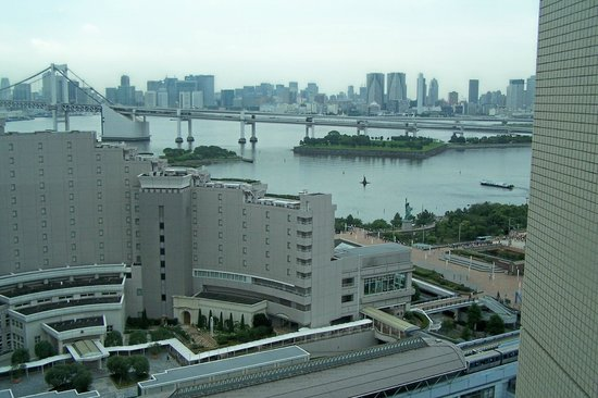 Grand Nikko Tokyo Daiba: View from Room looking toward mainland showing Rainbow Bridge, Train Station in fore-ground & pa