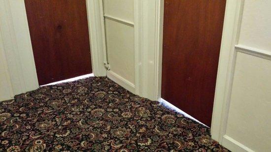 """White Hart Hotel: 2"""" gap under bedroom doors"""