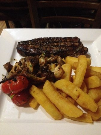 Retreat Grill, Bar and Restaurant: One hell of a steak!!!