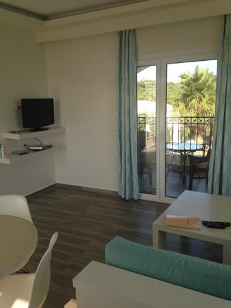 Erietta Luxury Apartments: Exit to balcony and TV with DVD