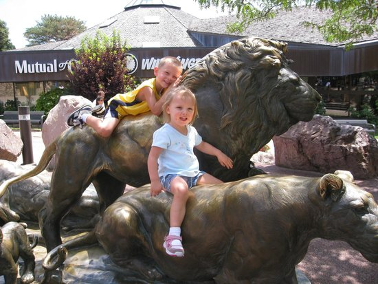 Henry Doorly Zoo: Climb on the lions at the entrance!  It is a tradition going back to the zoo's first visitors.