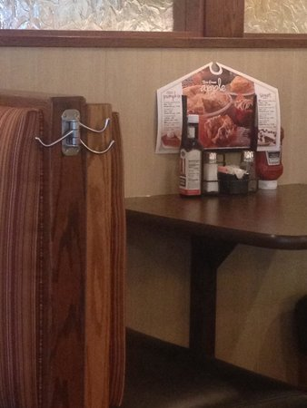 Bob Evans: Ingenious way to hang a coat or purse at the end of your booth