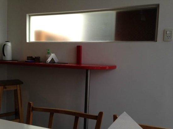 06 Soho Suites: Cocina con Muebles de Diseño