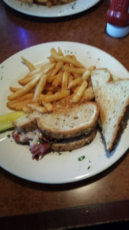 Olde New York: Pastrami and rye. Thick rye bread grilled with gooey swiss cheese.  Looks like a nice place.