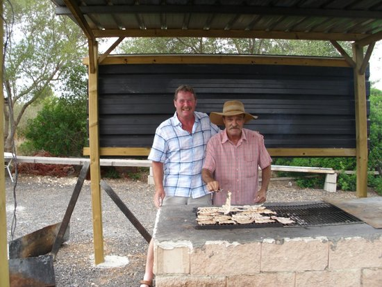No Frills Excursions : My husband with 'Juan' who cooked the meat for our barbecue.