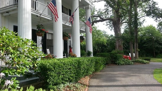 The Inn at Cape Cod: The front entry with flags