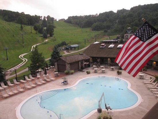 Seven Springs Mountain Resort Outdoor Pool With The Slopes Alpine Slide In Background