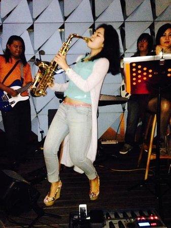 Ize Seminyak: Glendys Monica funky sax player playing live at Ize