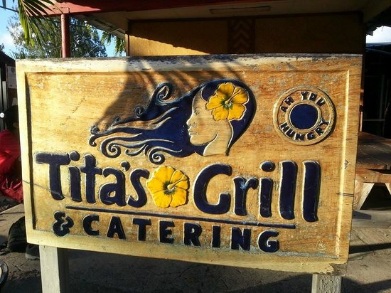 Tita's Grill and Catering : road side sign; rigjt across Kahuku High School