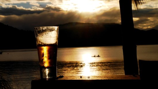 Palm Bay Resort Whitsundays: Enjoying a cold beer and watching the sunset from our own balcony