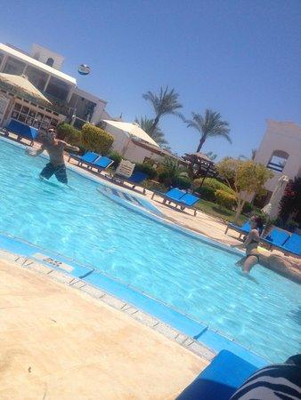 Sunbathing around the main pool near lobby