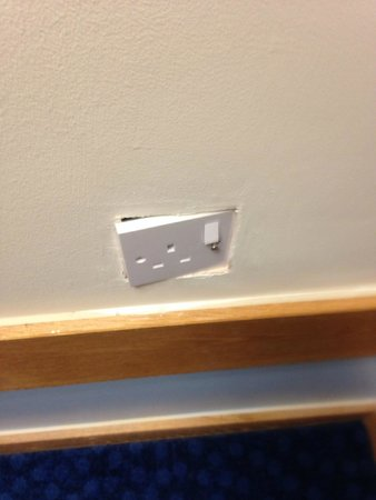 Travelodge Heathrow Terminal 5: Badly fitted electric socket in corridor