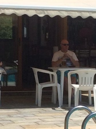 Hotel Costas Mary: Pavlos deep in thought enjoying nice glass of ice cold Mythos