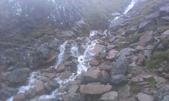 Ben Nevis: Spring running down from the top.