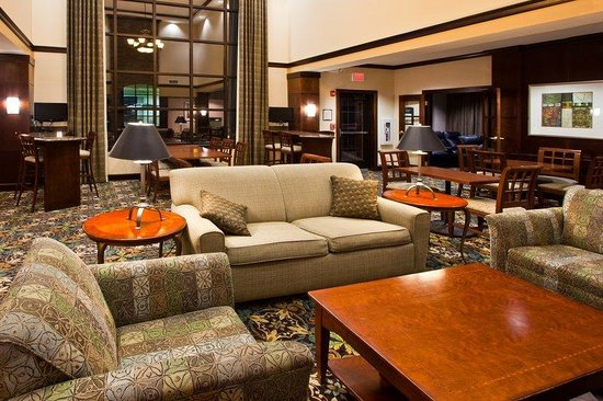 Staybridge Suites East Lansing-Okemos (MSU Area): Our cozy Great Room overlooks the beautiful courtyard