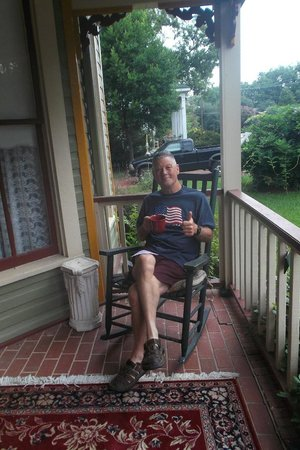 Benefield House Bed & Breakfast: My husband enjoying coffee on the porch!