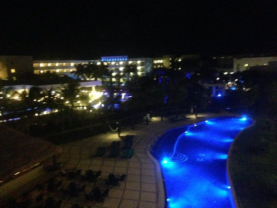 Secrets Silversands Riviera Cancun: night view of grounds and one of the pools