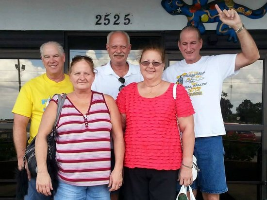 Brothers and sisters together on 2525 27th street, Bradenton, Fl in Mixon Fruit Farms entrance..
