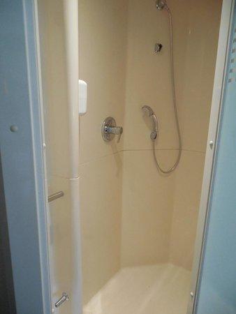 ibis budget Paris Porte de Montmartre : shower, toilet is in the room next to it. Sink is across the room