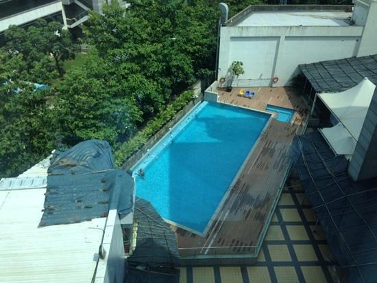 Ramada Navi Mumbai: Pool area with strange covers