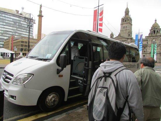 Timberbush Tours Glasgow - Day Tours: Tourist going up the coach