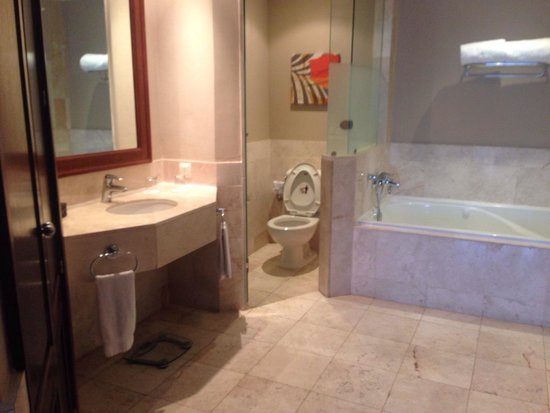 Now Larimar Punta Cana: One side of main bathroom in preferred club master suite ocean front view room