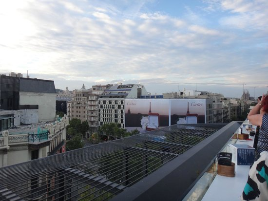 Condes De Barcelona: View from the roof top bar onto main street