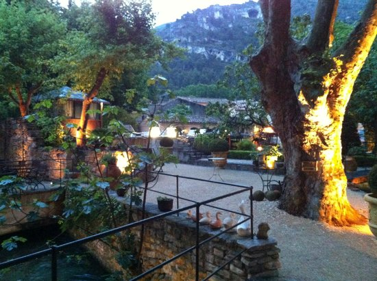 Hotel du Poete : This lovely outdoor space has the Sorgue running through it