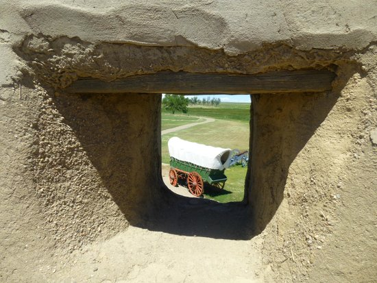 Bent's Old Fort National Historic Site: View of the wagon through a hole in the wall