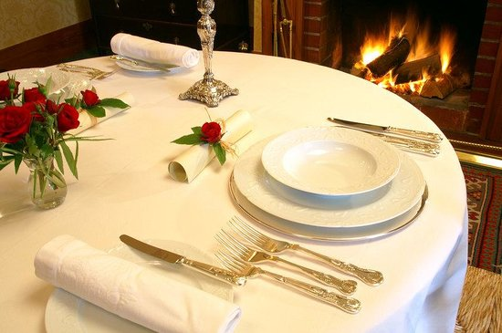 Timara Lodge: Table Set For Dinner Log Fire