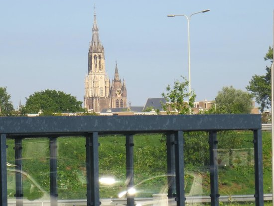 "WestCord Hotel Delft: View of Niew Kirk (""New Church"") in central Delf from hotel parking lot"