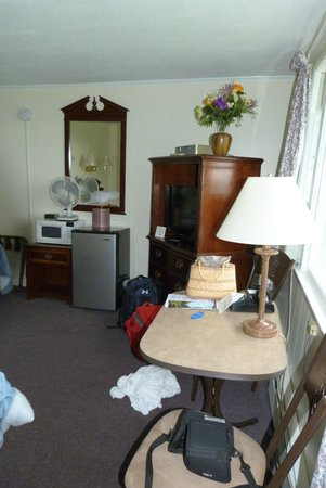 The Lake Inn at Mt. Sunapee : notice that the nightstand is at the foot of the bed holding the microwave