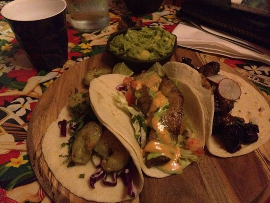 Amigos Mexican Restaurant: Zesty prawn, seasoned snapper and carnitas soft shell tacos with a side of guacamole