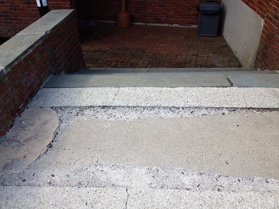 Resort and Conference Center at Hyannis: walkway to side building. loose pavement and bricks. no handrails.