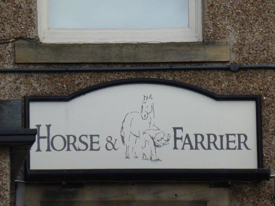 Horse and Farrier: sign at the back of the pub