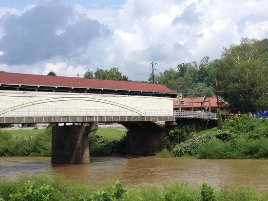 Philippi bridge: Covered bridge with Barbour Co. museum in background