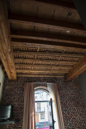 Ghent River Hotel: the wooden ceiling and the outer brick wall in our room