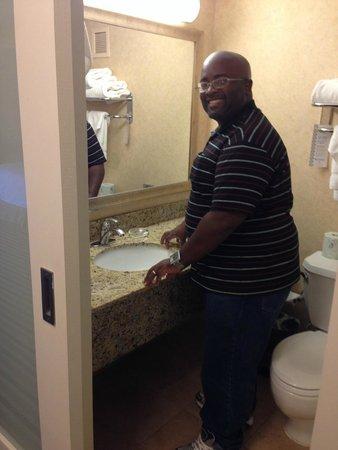 Wyndham Boston Beacon Hill: my husband is modeling the bathroom space