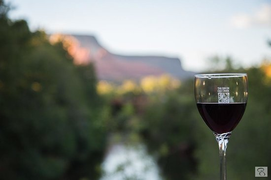 The Inn Above Oak Creek: A glass of wine from the room balcony